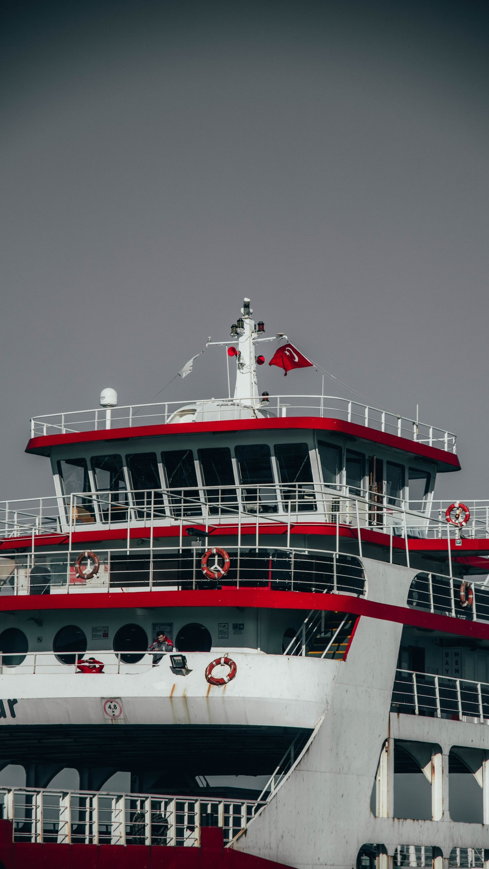 white and red ship on sea