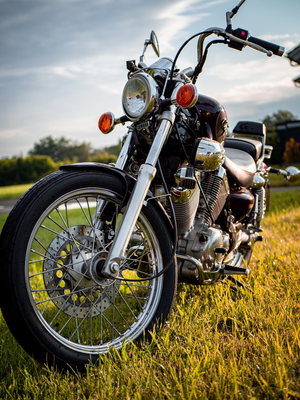 black and silver cruiser motorcycle on green grass field during daytime