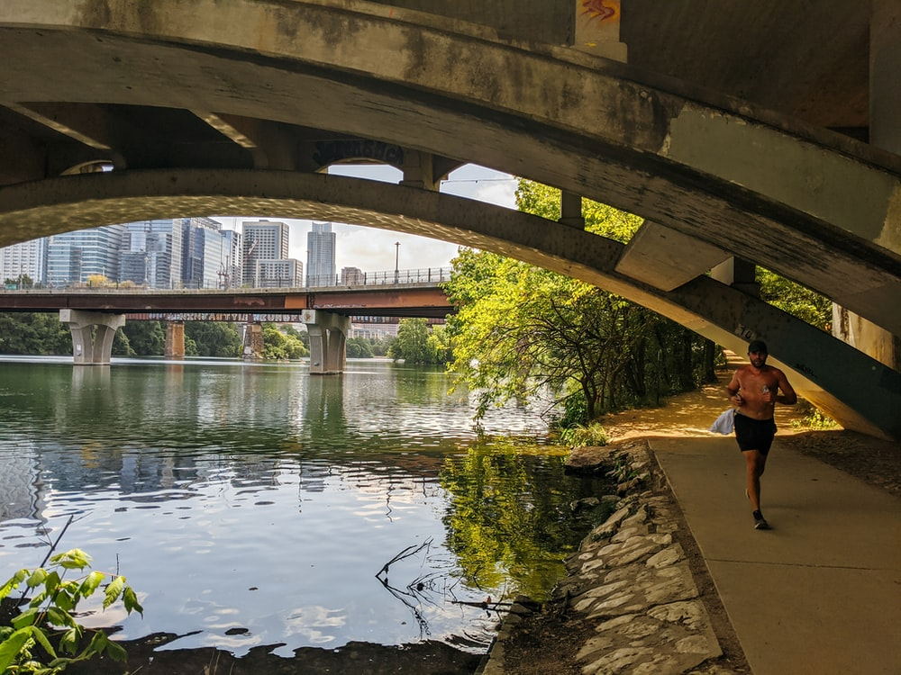 people walking on bridge over river during daytime