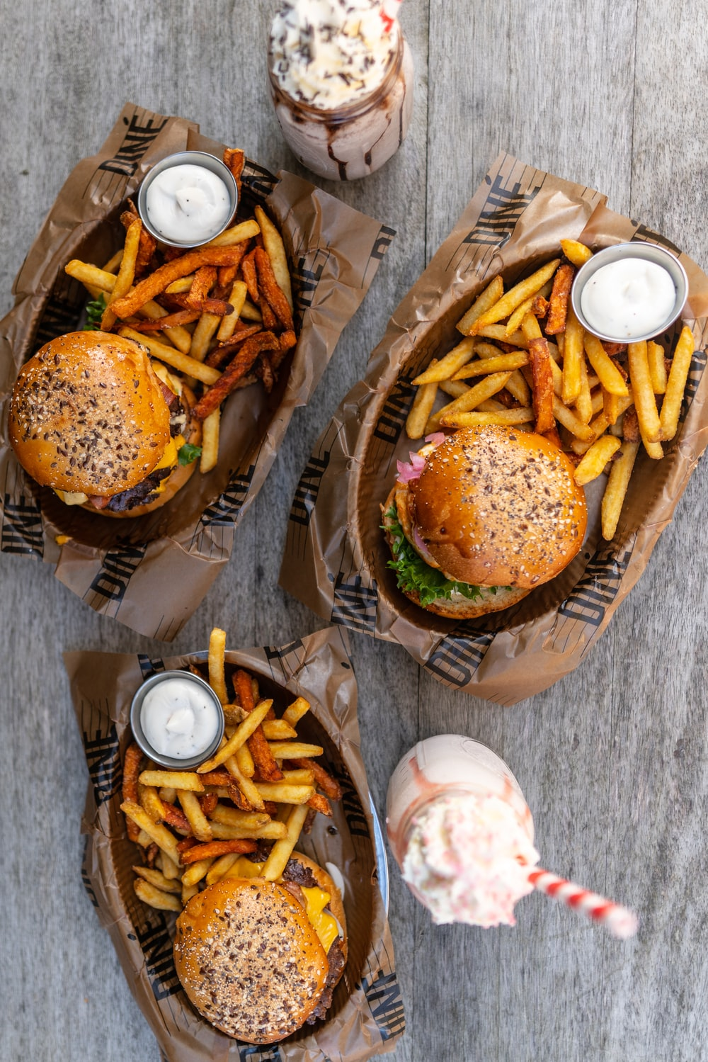burger and fries on brown paper plate