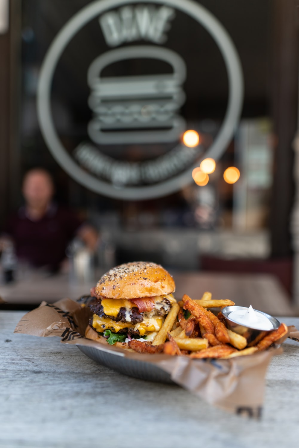 burger with fries on brown wooden table