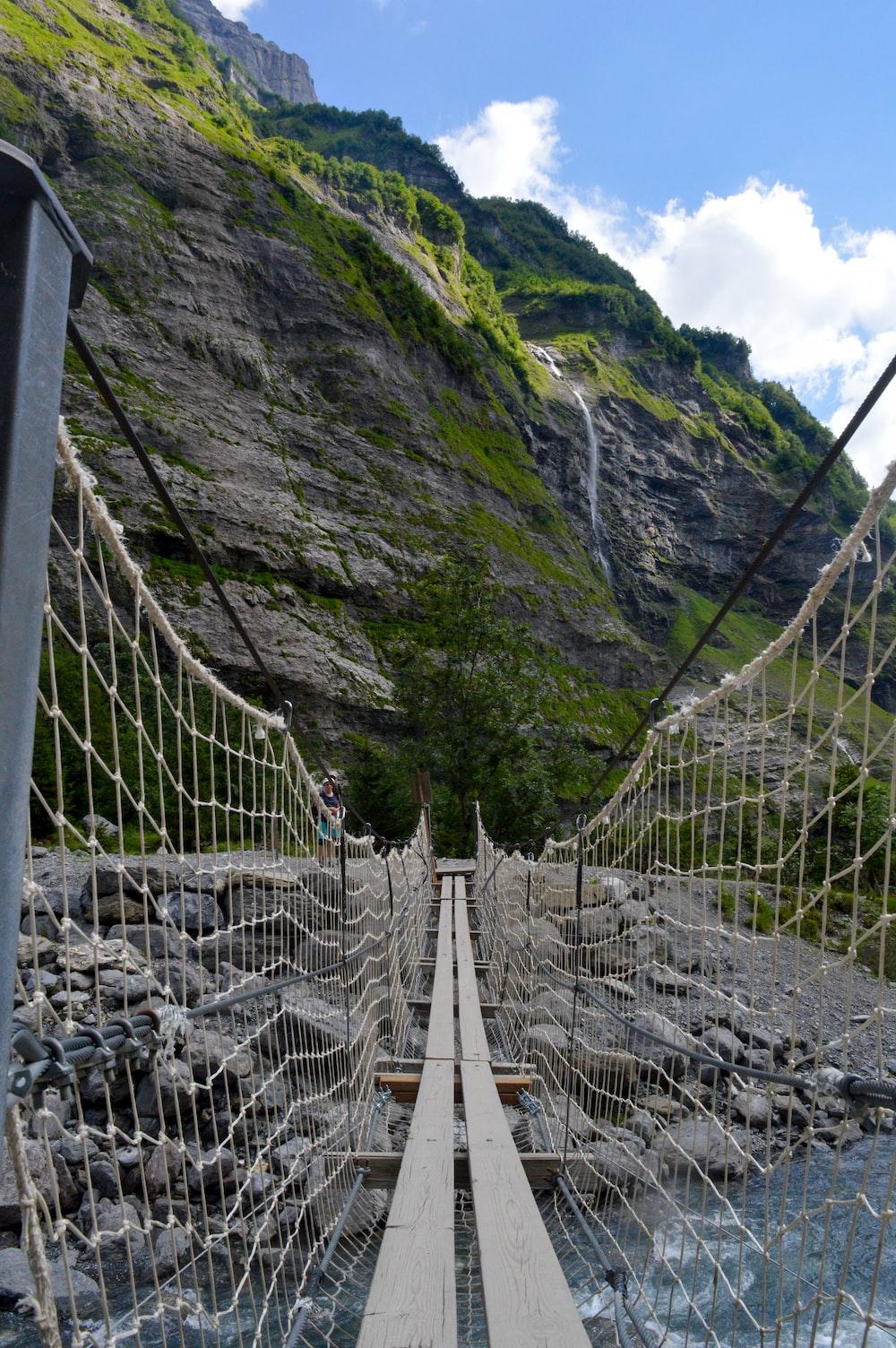 white wooden bridge on mountain