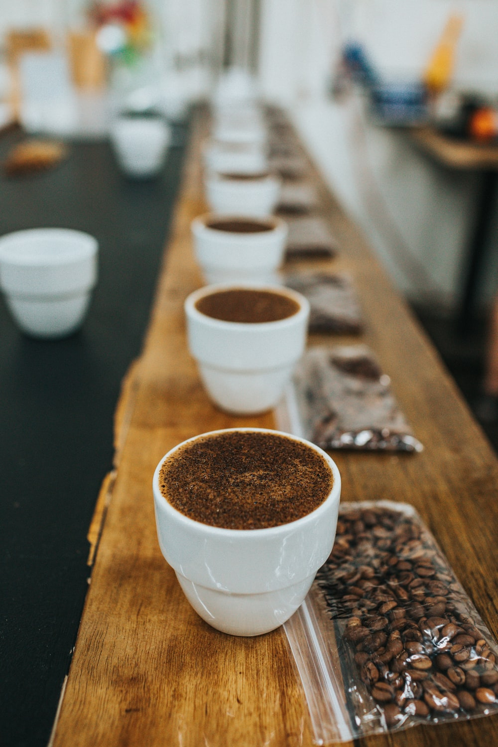 white ceramic cups on brown wooden table