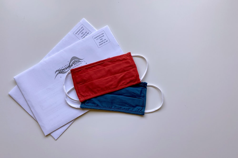 red and blue pouch on white paper