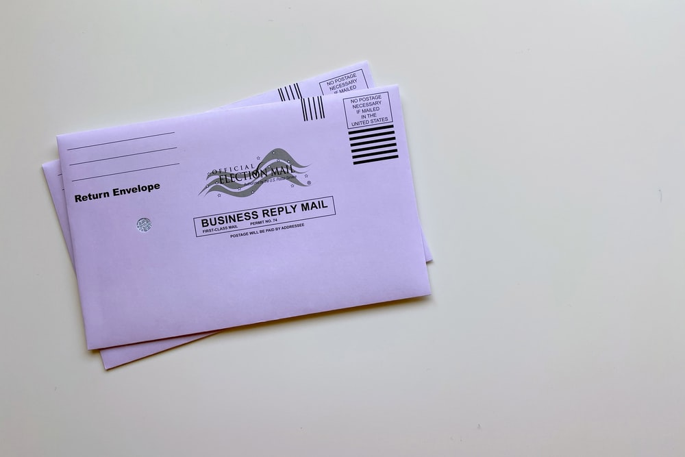 purple envelope on white table