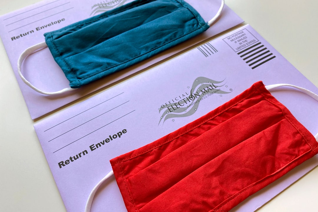 Election mail envelopes with face masks