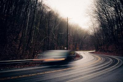 black asphalt road between bare trees during daytime indiana teams background