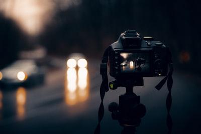 black dslr camera on tripod indiana zoom background