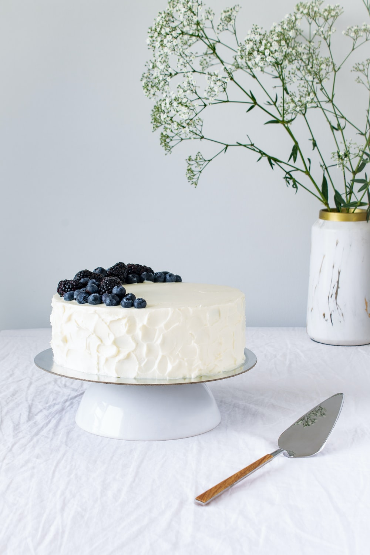 black berries on white cake