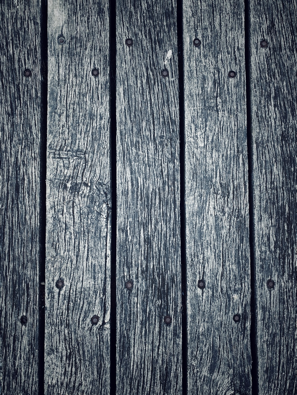 blue wooden plank in close up photography
