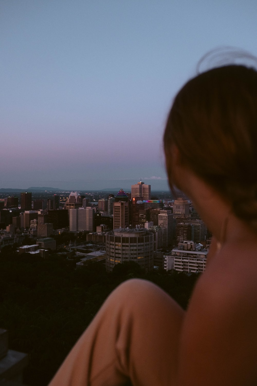 woman looking at the city during daytime
