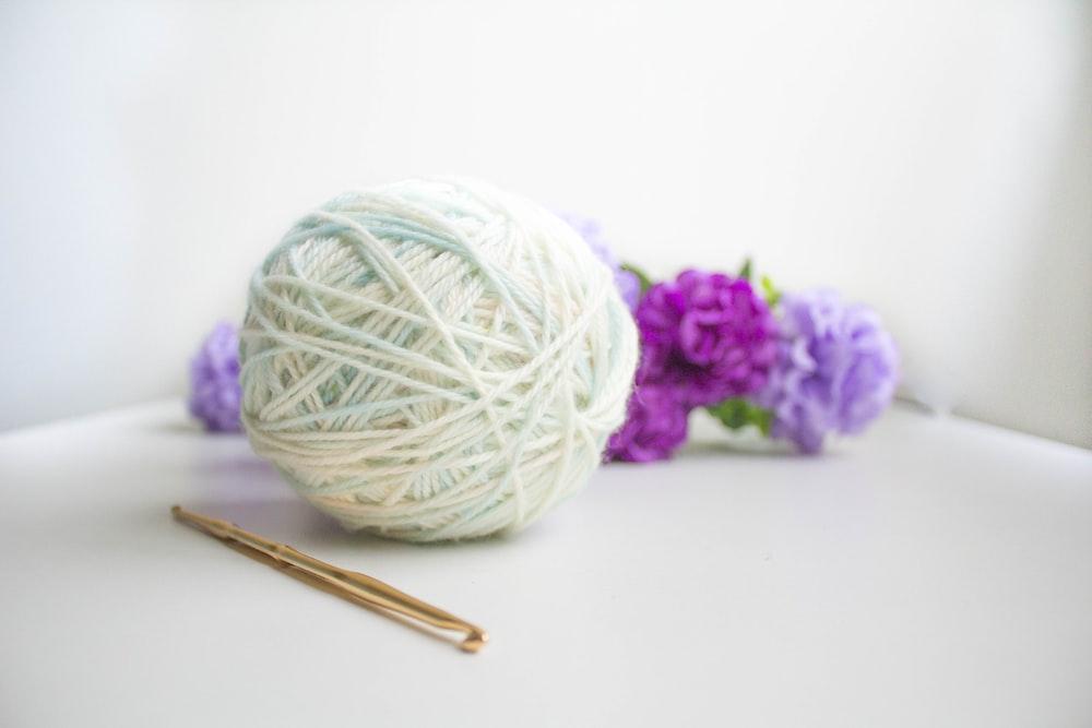 green and purple yarn ball