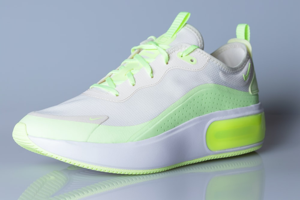 white and green nike athletic shoes