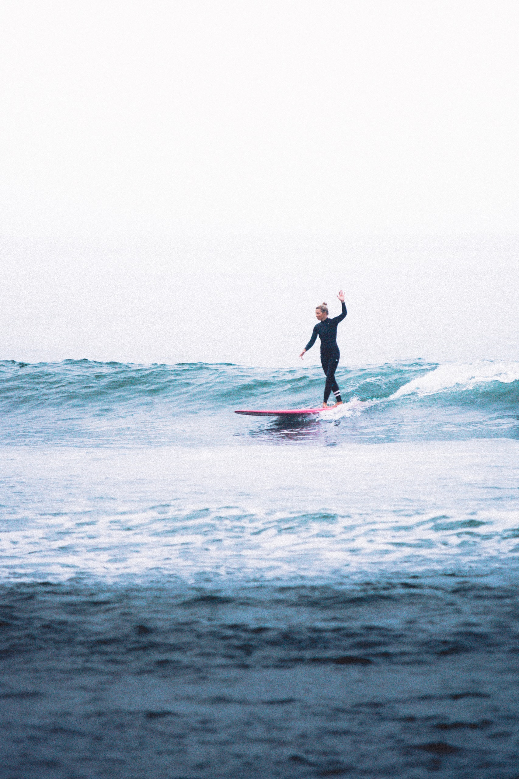 woman surfing on waves during daytime