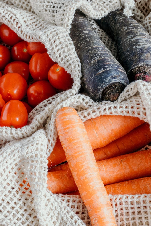 orange carrots on white knit textile