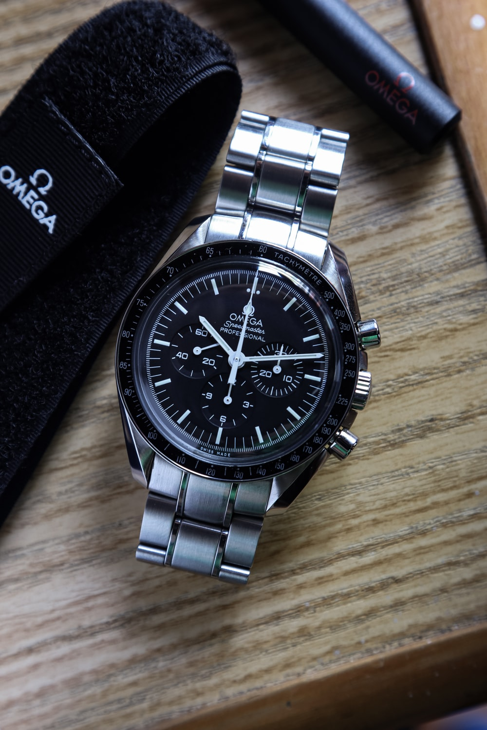 silver and black round chronograph watch