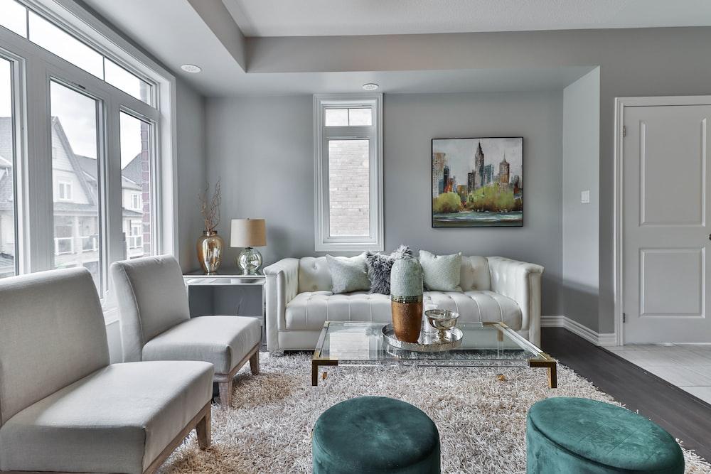 white sofa set near white wall