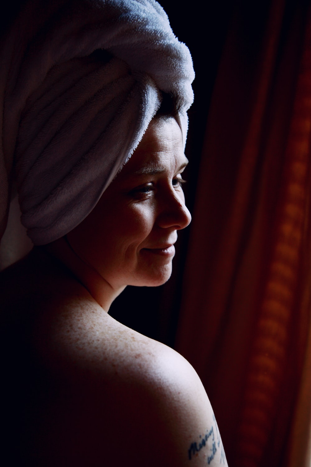 woman in white towel on head