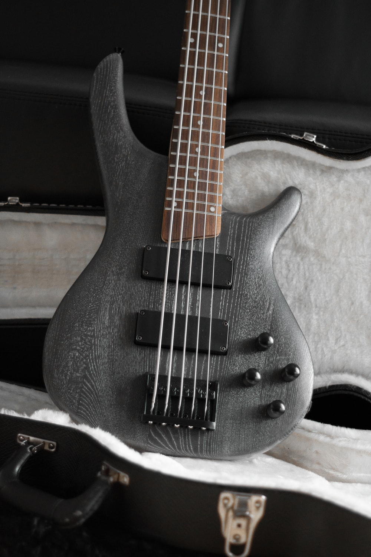 black electric guitar on black guitar case