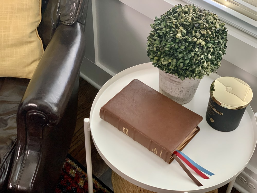 brown leather book cover on white round table