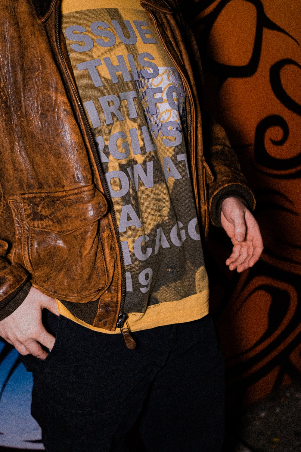 person in brown leather jacket