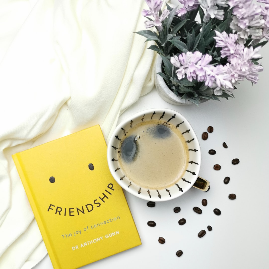 Friendship book featured with a coffee and a lavender plant