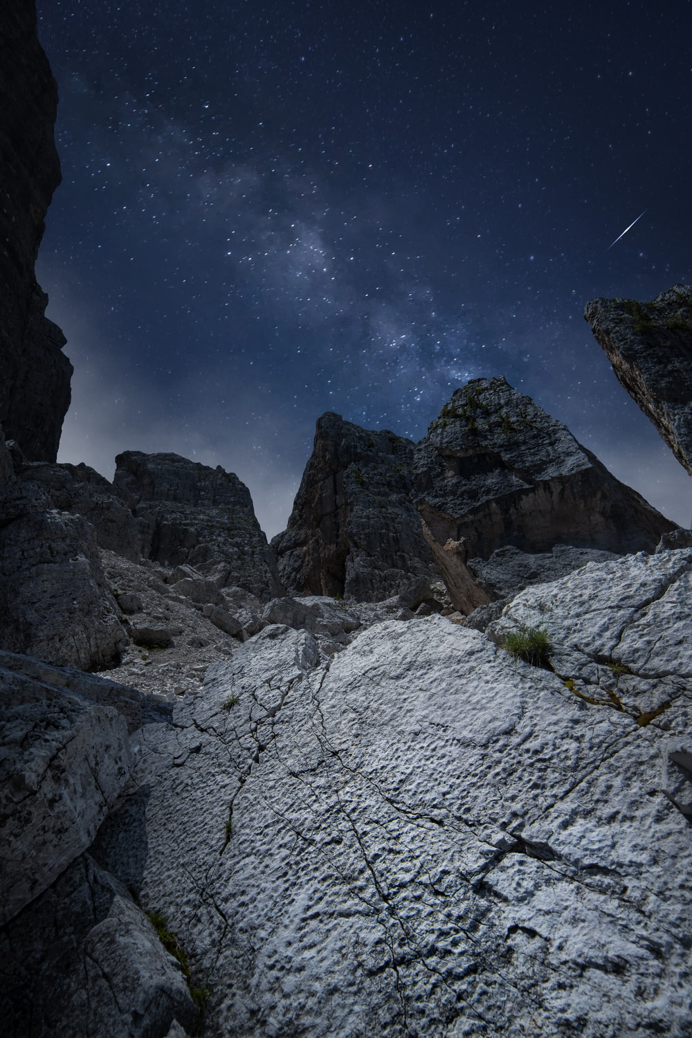 rocky mountain under blue sky during night time