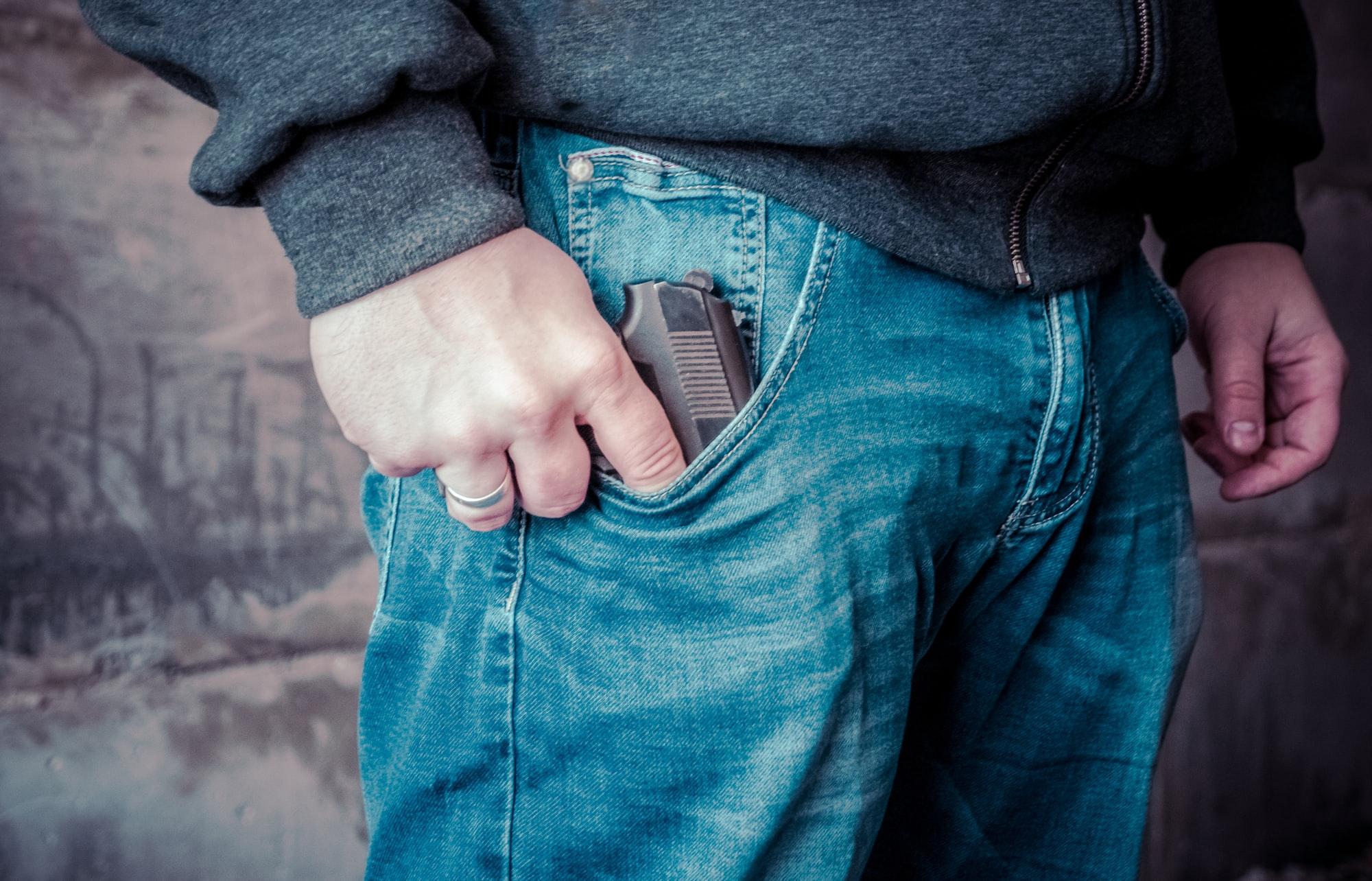 Terrorist thief man holding short gun in his hand