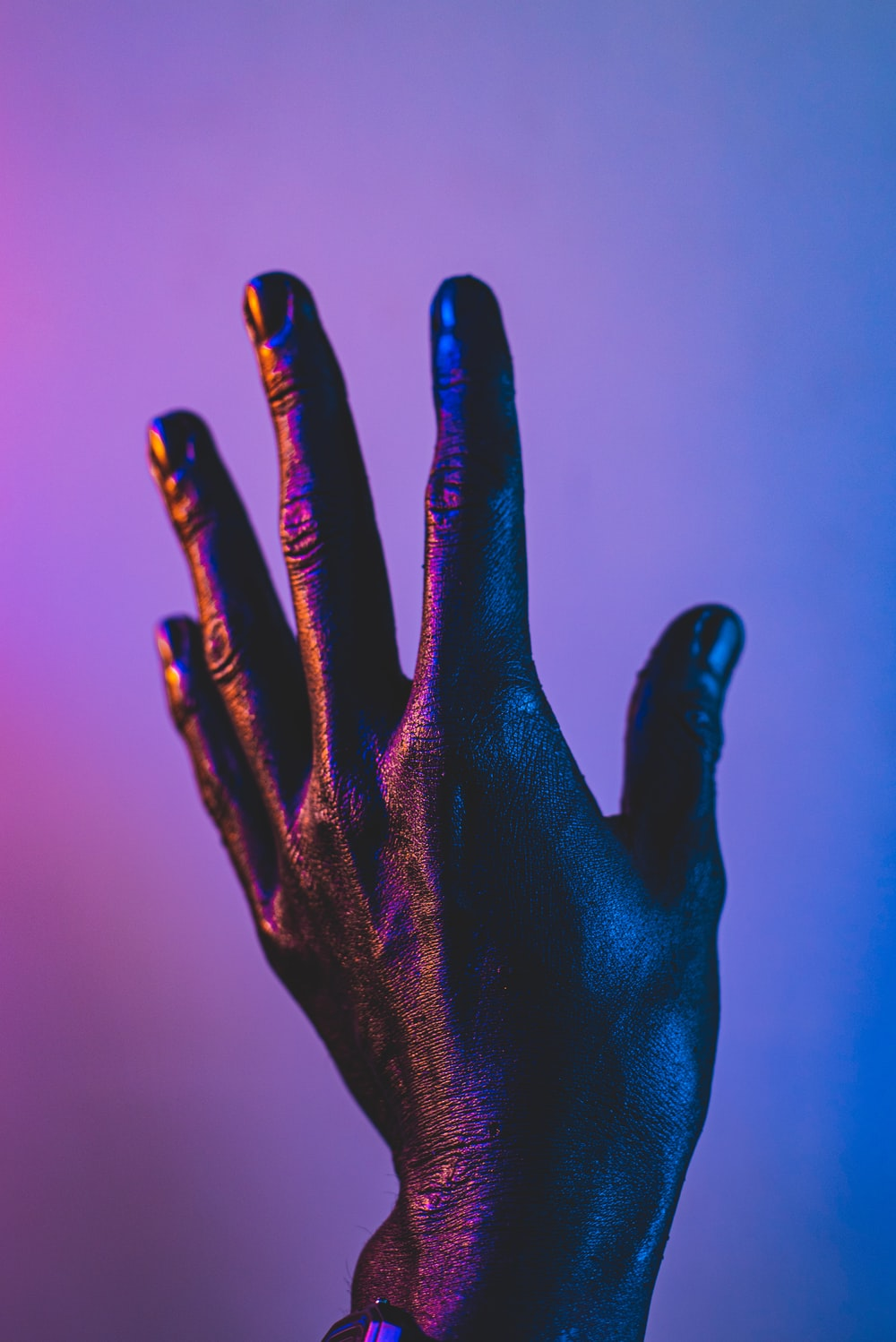 persons left hand with blue manicure