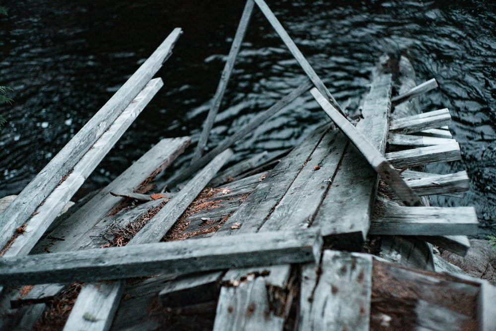 brown wooden plank on water