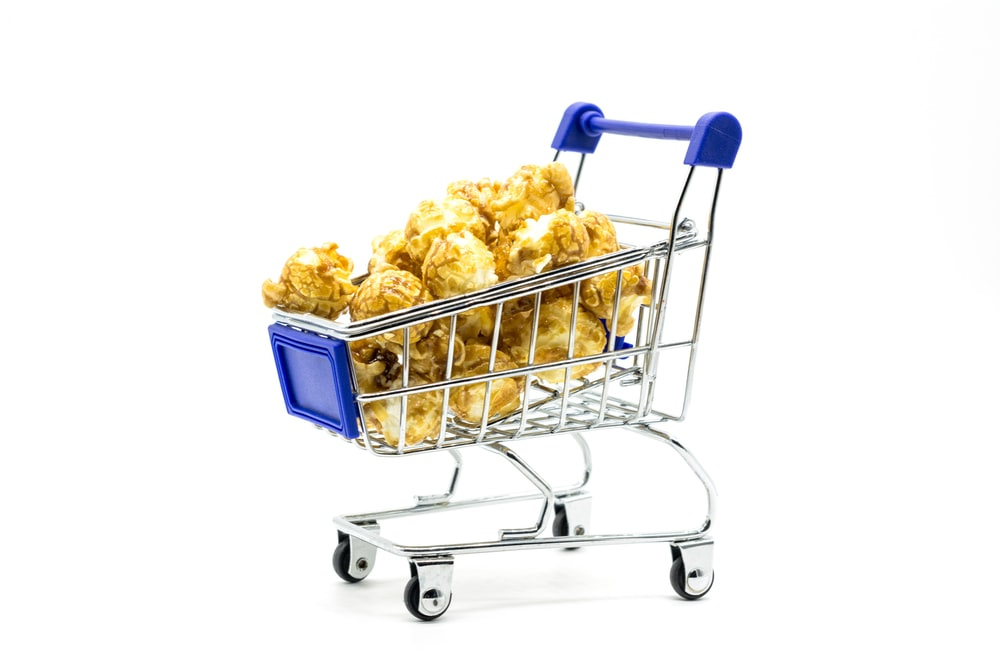 blue shopping cart with yellow and white ice cream