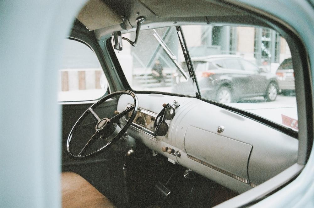 grey car steering wheel during daytime