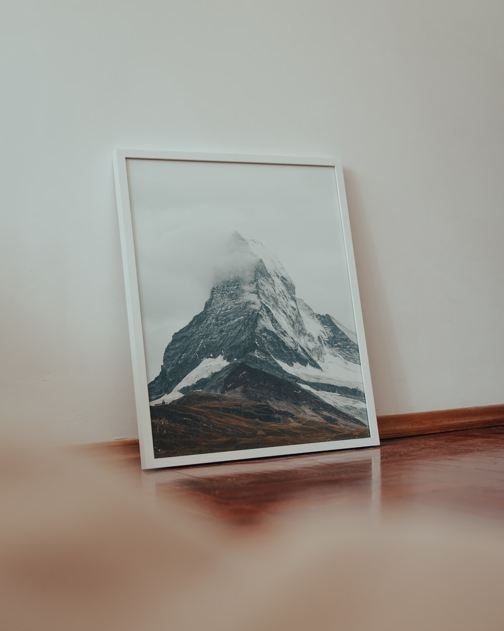 white wooden framed painting of mountain