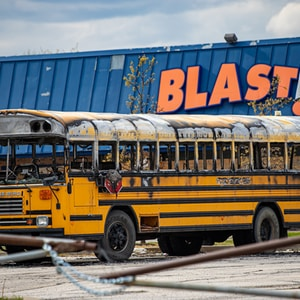 school bus parked near white building during daytime