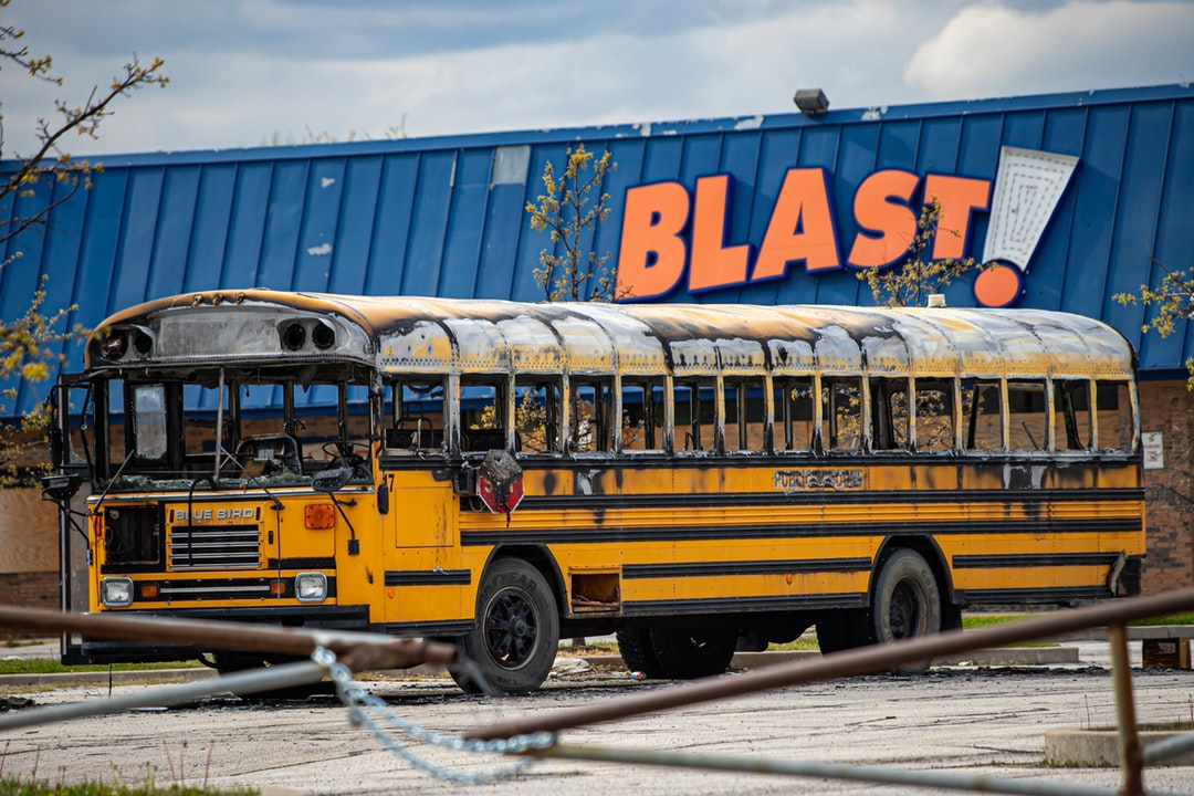 Blast - burned school bus in the parking lot