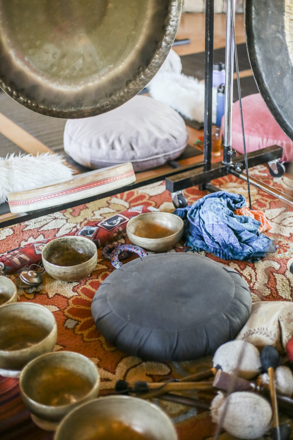 black round table with blue and white textile