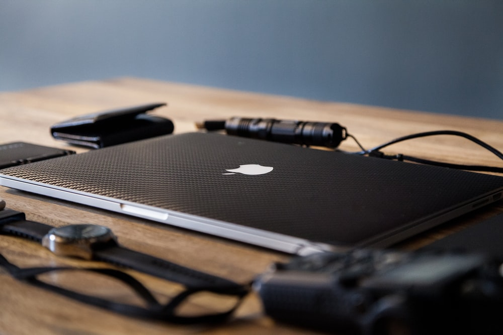 macbook pro on brown wooden table