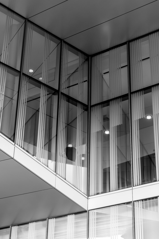 grayscale photo of glass windows