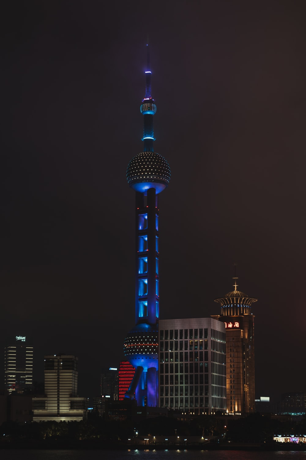 white and blue tower during night time