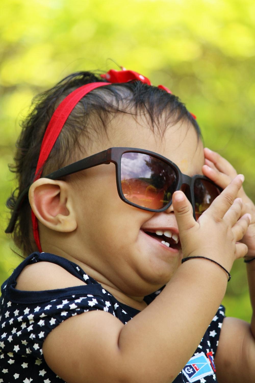 girl in black framed sunglasses