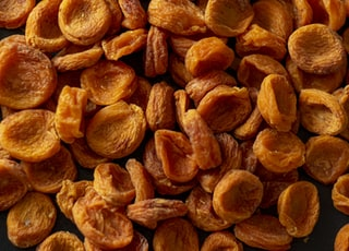 brown almond nuts on brown wooden surface
