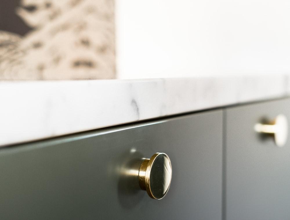 white wooden door with gold door knob