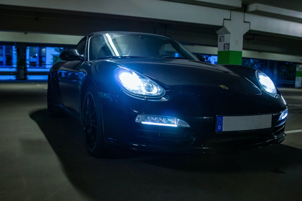black porsche 911 parked in garage