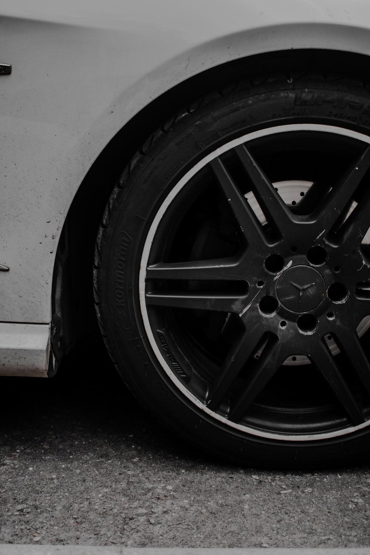 black 5 spoke wheel with tire