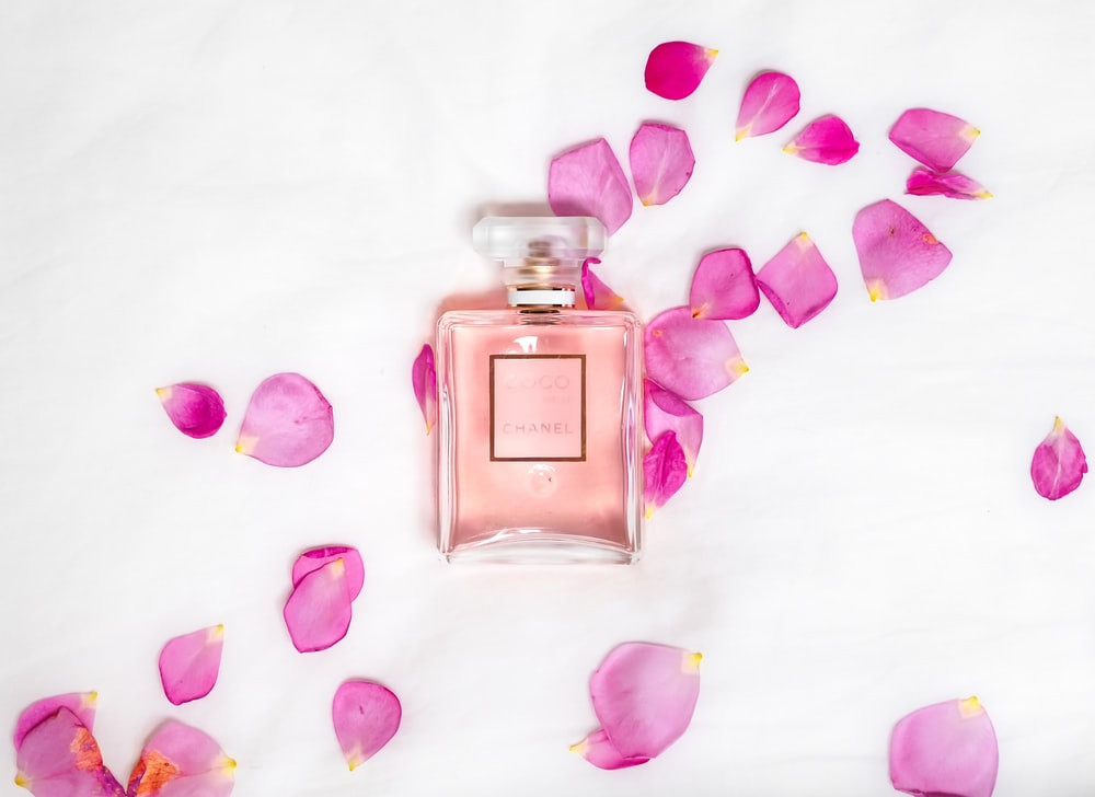perfume bottle with pink petals