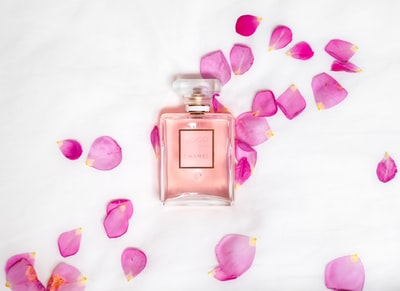 perfume bottle with pink petals petal zoom background