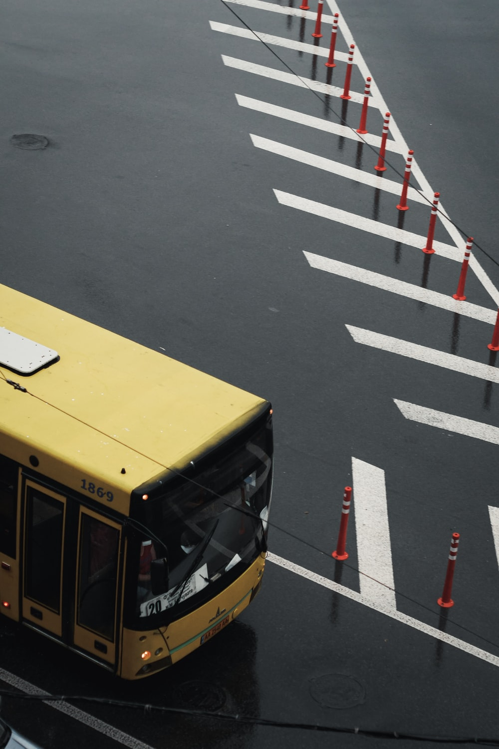 yellow bus on gray asphalt road during daytime
