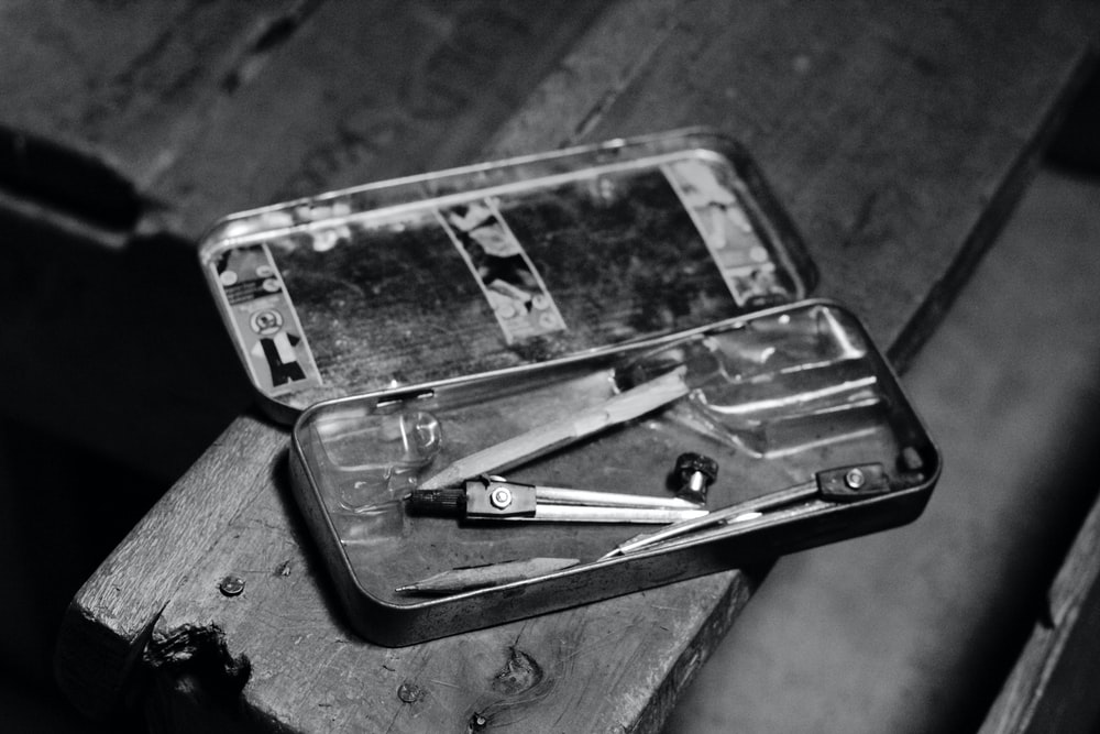 grayscale photo of smartphone on table