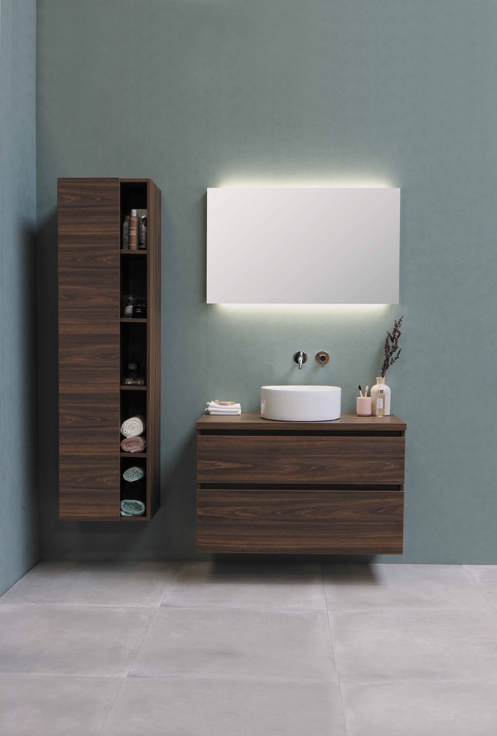 white ceramic sink beside brown wooden cabinet