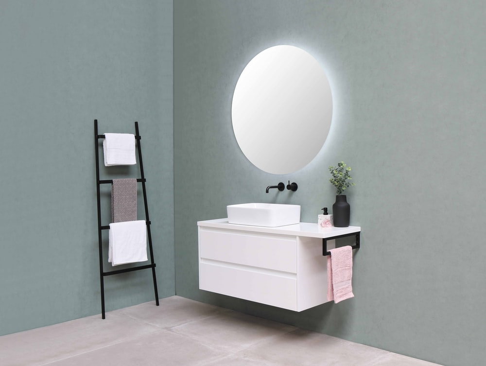 white wooden vanity sink with mirror